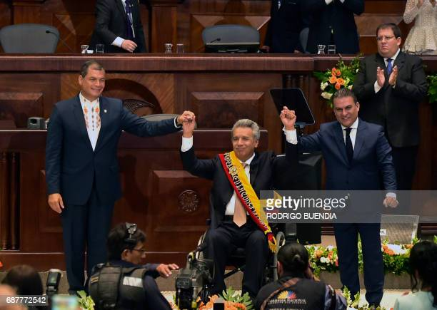Ecuadorean outgoing President Rafael Correa and the president of the Ecuadorean National Assembly Jose Serrano Salgado raise Ecuadorean new President...