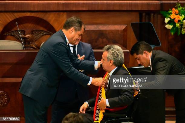 Ecuadorean outgoing President Rafael Correa gives Ecuadorean new President Lenin Moreno the presidential sash at the National Assembly in Quito on...