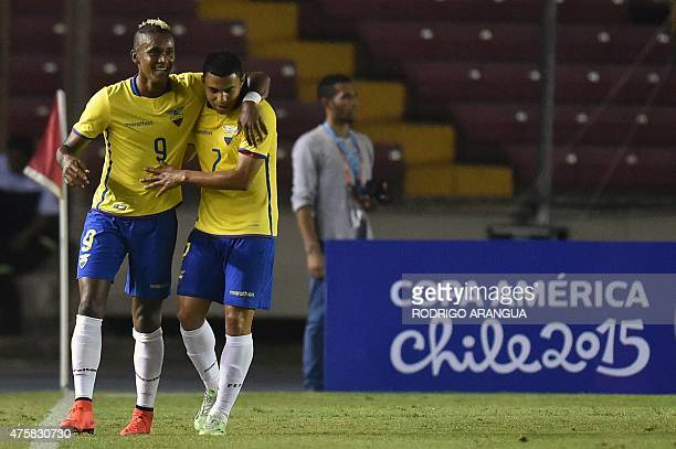Ecuadorean players Fidel Martinez and Jefferson Montero celebrate after scoring against Panama during a friendly football match at the Rommel...