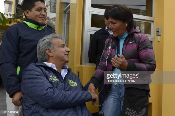 Ecuadorean presidencial candidate Lenin Moreno greets a woman after an interview at a local radio in Quito on March 10 2017 Campaign opened for...