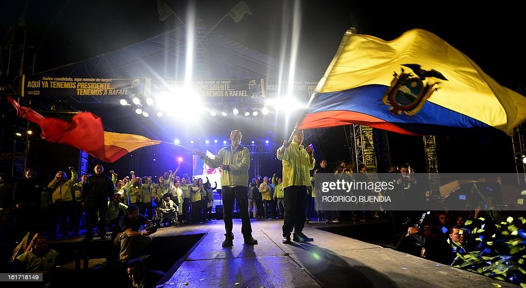 Ecuadorean President and candidate for re-election, Rafael Correa (R) and his candidate for vice president, Jorge Glass, wave flags at their final political rally, in Quito, Ecuador, on February 14, 2013. With a support ranging between 48.18 and 61.5 percent of the voters --according to three different surveys-- Correa would be reelected in the upcoming February 17 election.