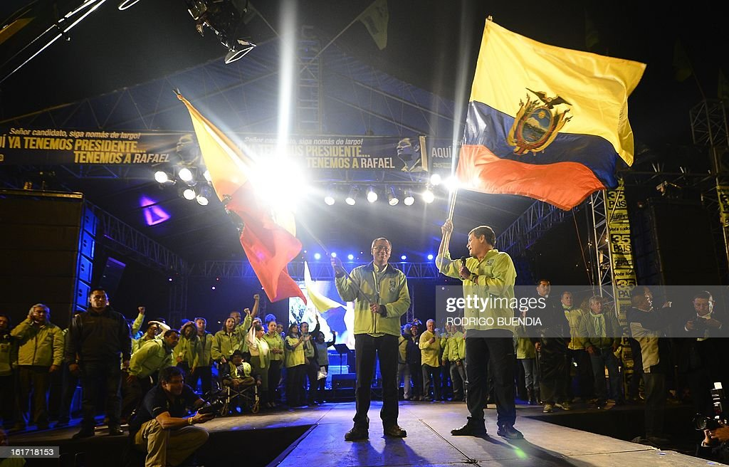 Ecuadorean President and candidate for reelection, Rafael Correa (R) and his candidate for vice president, Jorge Glass, wave flags at their final political rally, in Quito, Ecuador, on February 14, 2013. With a support ranging between 48.18 and 61.5 percent of the voters --according to three different surveys-- Correa would be reelected in the upcoming February 17 election. AFP PHOTO/RODRIGO BUENDIA