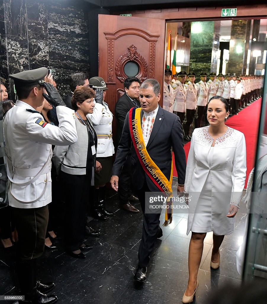 Ecuadorean President Rafael Correa and the president of the National Assembly, Gabriela Rivadeneira, arriving at the legislature where Correa is to deliver his annual message to the Nation, the last of his administration, in Quito on May 24, 2016. / AFP / RODRIGO