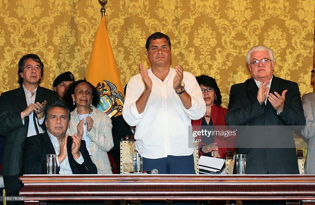 Ecuadorean President Rafael Correa applauds with Ecuadorean Vice-President Lenin Moreno (L), and the president of the Ecuadorean National Assembly, Fernando Cordero (R), following his speech to offer condolences after knowing of Venezuelan President Hugo Chavez's death in Quito on March 5, 2013.