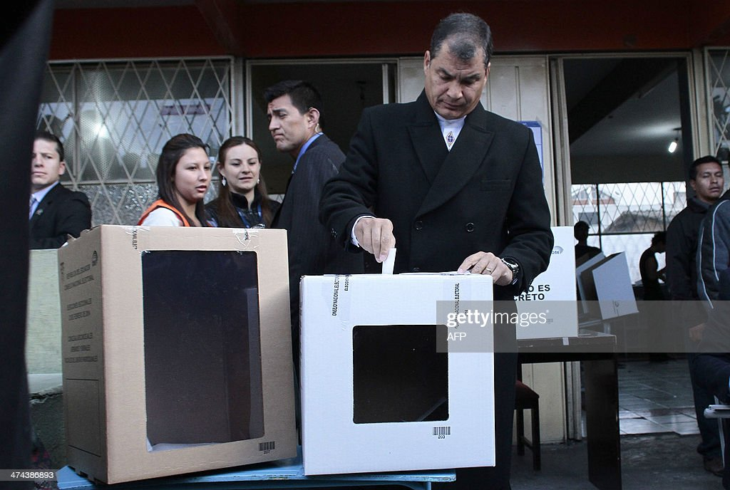 Ecuadorean President Rafael Correa casts his vote at a polling station in Quito, as the country holds municipal elections on February 23, 2014.