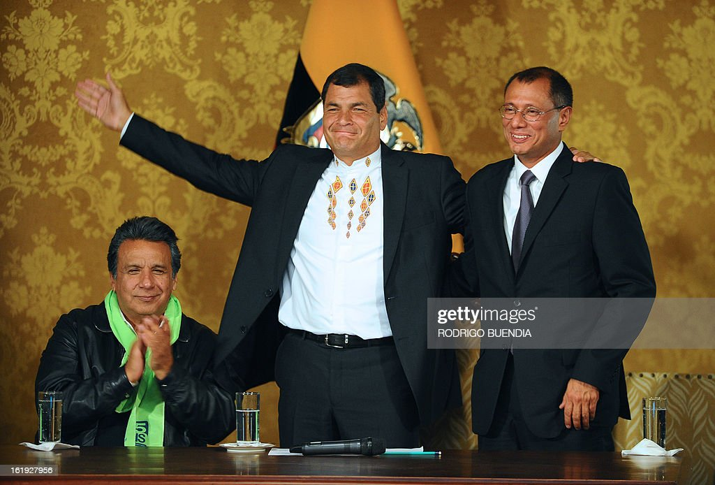 Ecuadorean President Rafael Correa (C) celebrates his re-election flanked by his current Vice-President Lenin Moreno (L) and his Vice-President elect Jorge Glass, at the Carondelet presidential palace in Quito on February 17, 2013. President Rafael Correa declared victory in the first-round of Ecuador's presidential vote Sunday as he celebrated with thousands of supporters in the South American country's Andean capital. Exit polls gave him about 60 percent of the vote -- and a roughly 40-point lead over his nearest rival, banker Guillermo Lasso. AFP PHOTO/RODRIGO BUENDIA