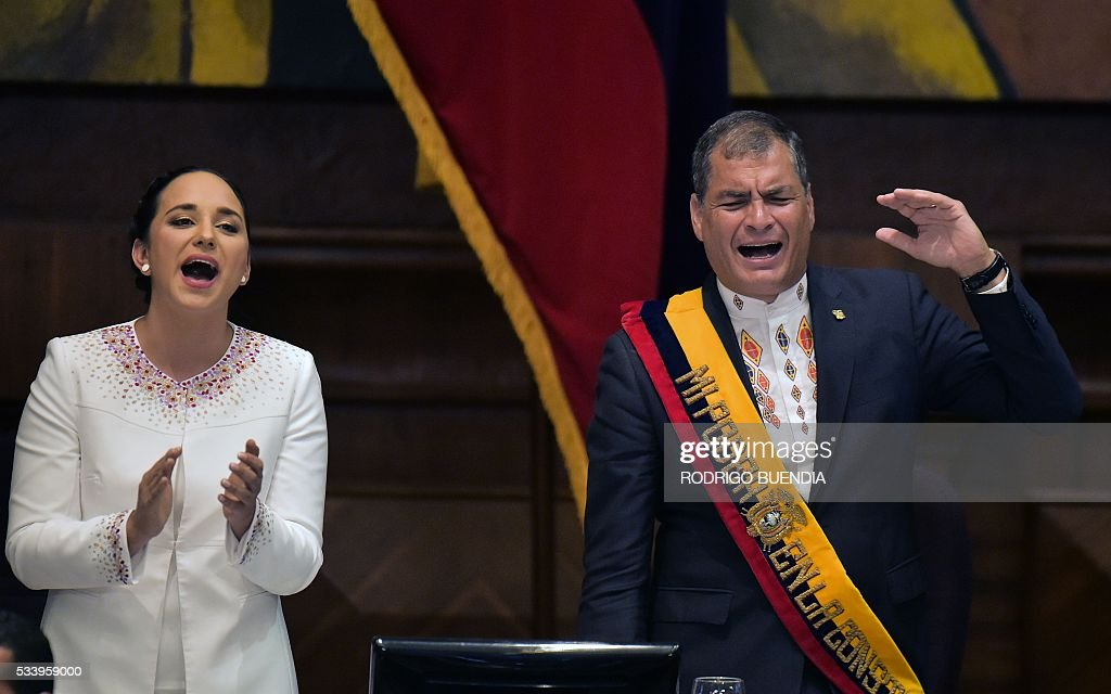 Ecuadorean President Rafael Correa delivers his annual message to the Nation before the National Assembly, the last of his administration, in Quito on May 24, 2016, standing next to the president of the legislature, Gabriela Rivadeneira. / AFP / RODRIGO