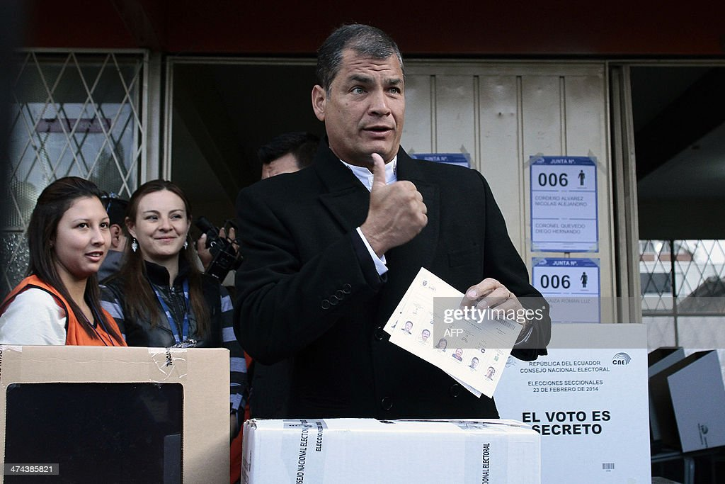 Ecuadorean President Rafael Correa gives his thumb up as he casts his vote at a polling station in Quito, as the country holds municipal elections on February 23, 2014.