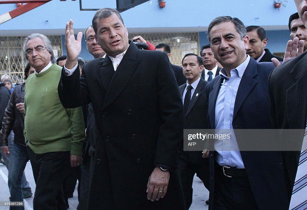 Ecuadorean President Rafael Correa (C), is accompanied by the ruling party's candidate for Quito's Mayor's Office, Augusto Barrera (R) and the Prefecture of Pichincha, Gustavo Baroja, who seeks reelection, as he leaves a polling station in Quito, as the country holds municipal elections on February 23, 2014.