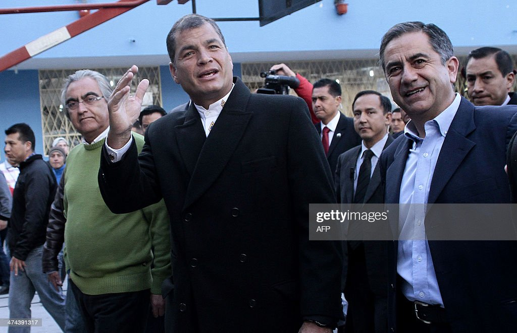 Ecuadorean President Rafael Correa (C), is accompanied by the ruling party's candidate for Quito's Mayor's Office, Augusto Barrera (R) and the Prefecture of Pichincha, Gustavo Baroja (L), who seeks reelection, as he leaves a polling station in Quito, as the country holds municipal elections on February 23, 2014.