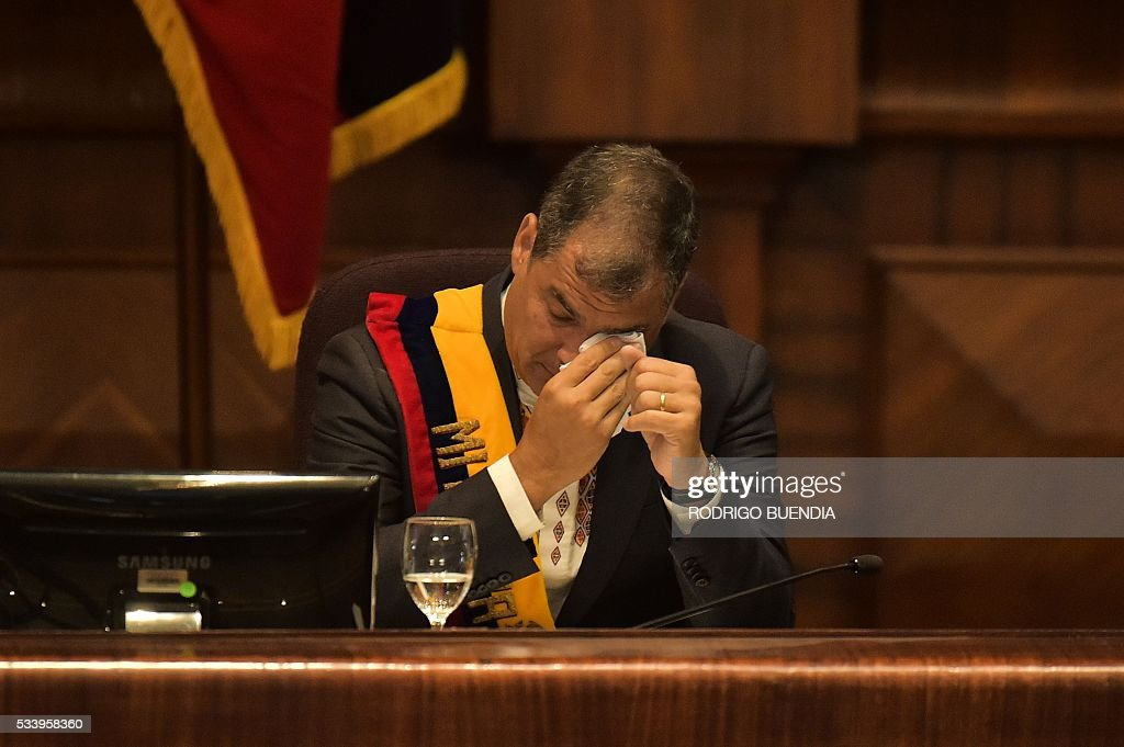 Ecuadorean President Rafael Correa is moved when he hears a song as he delivers his annual message to the Nation before the National Assembly, the last of his administration, in Quito on May 24, 2016. / AFP / RODRIGO