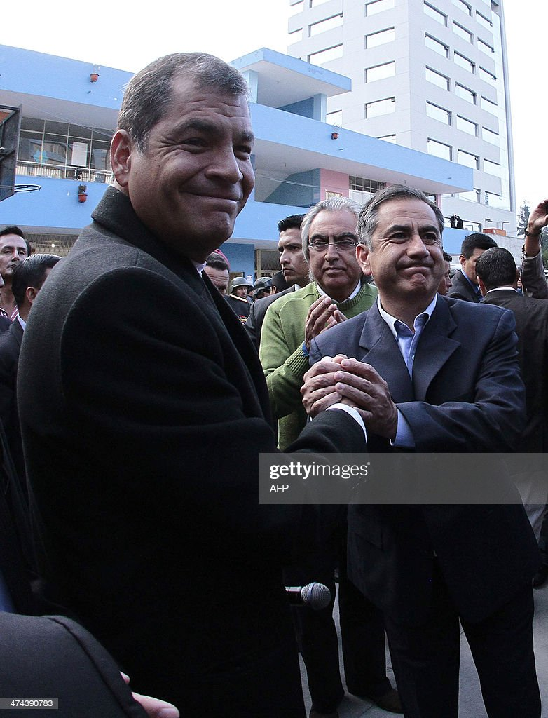 Ecuadorean President Rafael Correa (L) poses with the ruling party's candidate for Quito's Mayor's Office, Augusto Barrera, after casting his vote at a polling station in Quito, as the country holds municipal elections on February 23, 2014.