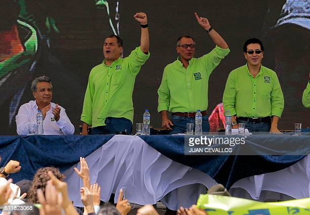 Ecuadorean President Rafael Correa raises his fist next to Ecuadorean VicePresident Jorge Glas after Ecuadorean Lenin Moreno was annouced as...