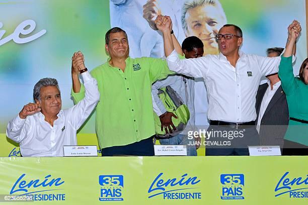 Ecuadorean President Rafael Correa raises the hands of Ecuadorean presidential candidate for the ruling Alianza Pais party Lenin Moreno and his...