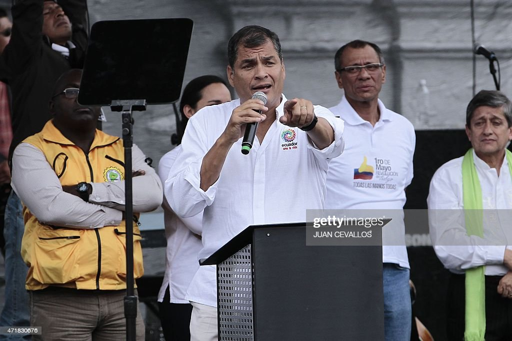 Ecuadorean President <a gi-track='captionPersonalityLinkClicked' href=/galleries/search?phrase=Rafael+Correa&family=editorial&specificpeople=2294079 ng-click='$event.stopPropagation()'>Rafael Correa</a> (C) speaks during the May Day celebrations on May 1, 2015 in Quito. AFP PHOTO/JUAN CEVALLOS.