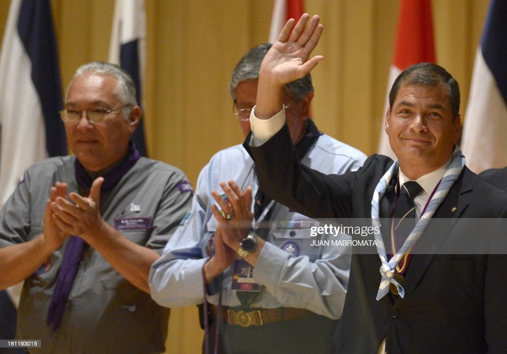 Ecuadorean President Rafael Correa (R) waves before delivering a speech during the opening ceremony of the XXV Interamerican Scouts Conference in Buenos Aires, Argentina on September 19, 2013.