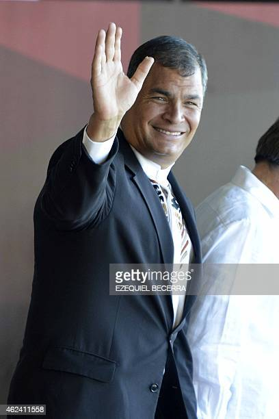 Ecuadorean President Rafael Correa waves upon his arrival at the Santa Maria airport 22 km north of San Jose on January 28 2015 to take part in the...