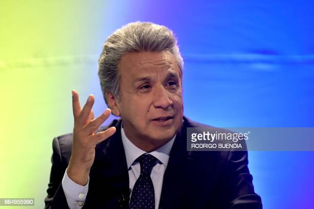 Ecuadorean presidentelect Lenin Moreno speaks with foreign at Alianza Pais party headquarters in Quito on April 5 2017 Ecuador's electoral authority...