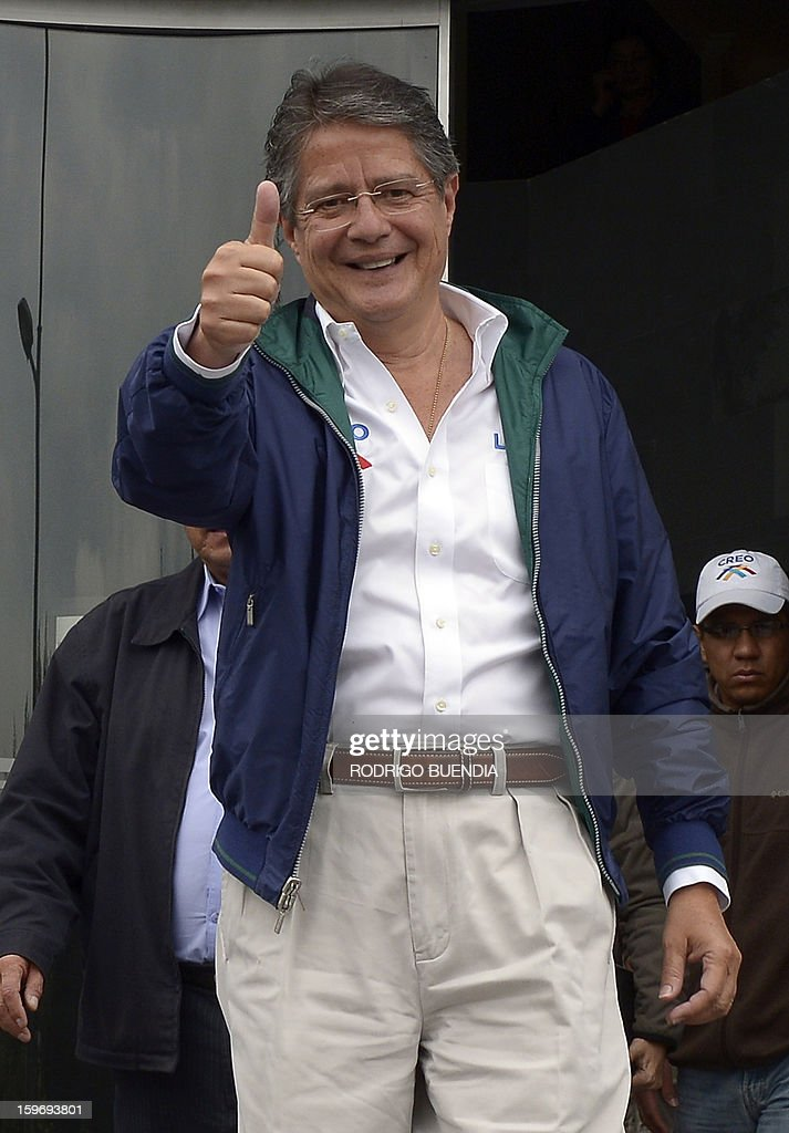 Ecuadorean presidential candidate, banker Guillermo Lasso, of the CREO party, gives his thumb up while leaving a local radio station on January 18, 2013, in Quito. Polls show President Rafel Correa, a leftist who has been in office since 2007, the overwhelming favorite to win in the first round of voting giving a lead of as many as 49 percentage points over his closest rival, banker Guillermo Lasso, for the upcoming February 17 elections. AFP PHOTO/Rodrigo BUENDIA