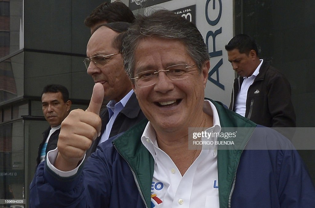 Ecuadorean presidential candidate, banker Guillermo Lasso, of the CREO party, waves while leaving a local radio station on January 18, 2013, in Quito. Polls show President Rafel Correa, a leftist who has been in office since 2007, the overwhelming favorite to win in the first round of voting giving a lead of as many as 49 percentage points over his closest rival, banker Guillermo Lasso, for the upcoming February 17 elections. AFP PHOTO/Rodrigo BUENDIA