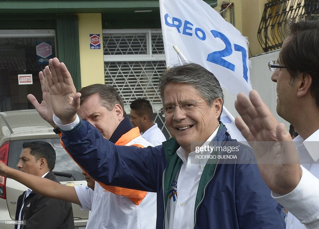 Ecuadorean presidential candidate, banker Guillermo Lasso, of the CREO party, waves at supporters as he campaigns in northern Quito on January 18, 2013. Polls show President Rafel Correa, a leftist who has been in office since 2007, the overwhelming favorite to win in the first round of voting giving a lead of as many as 49 percentage points over his closest rival, Lasso, for the upcoming February 17 elections. AFP PHOTO/Rodrigo BUENDIA
