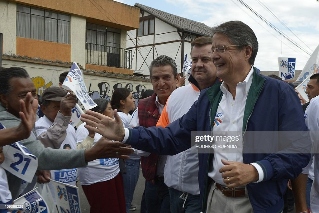 Ecuadorean presidential candidate, banker Guillermo Lasso (R), of the CREO party, greets supporters as he campaigns in northern Quito on January 18, 2013. Polls show President Rafel Correa, a leftist who has been in office since 2007, the overwhelming favorite to win in the first round of voting giving a lead of as many as 49 percentage points over his closest rival, Lasso, for the upcoming February 17 elections. AFP PHOTO/Rodrigo BUENDIA