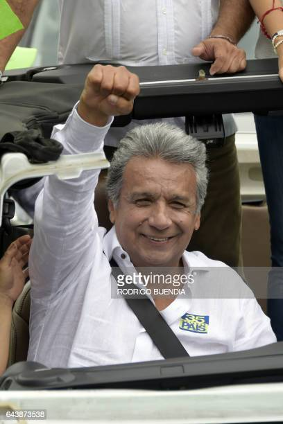 Ecuadorean presidential candidate for the Alianza Pais party Lenin Moreno rises his fist towards his supporters during a motorcade in Guayaquil...