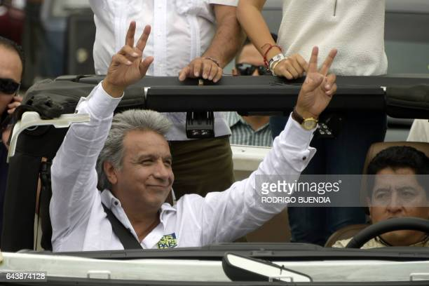 Ecuadorean presidential candidate for the Alianza Pais party Lenin Moreno waves to supporters during a motorcade in Guayaquil Ecuador on February 22...