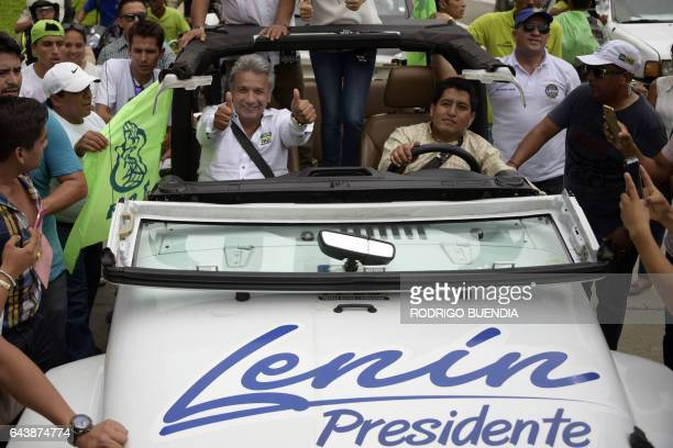 Ecuadorean presidential candidate for the Alianza Pais party Lenin Moreno gives thumbs up to supporters during a motorcade in Guayaquil Ecuador on...