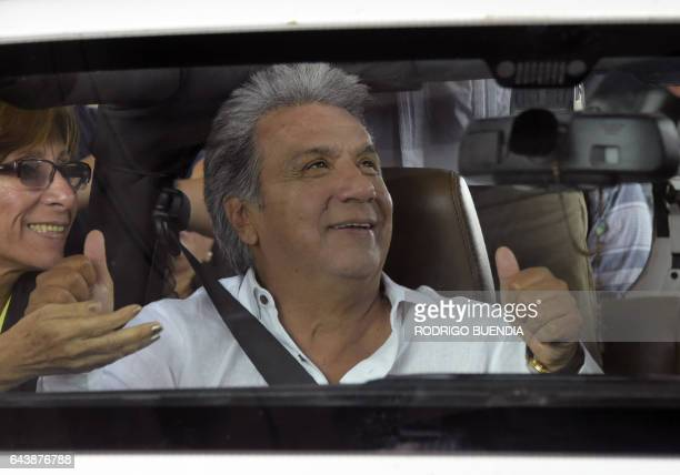 Ecuadorean presidential candidate for the Alianza Pais party Lenin Moreno gives a thumbs up to supporters during a motorcade in Guayaquil Ecuador on...
