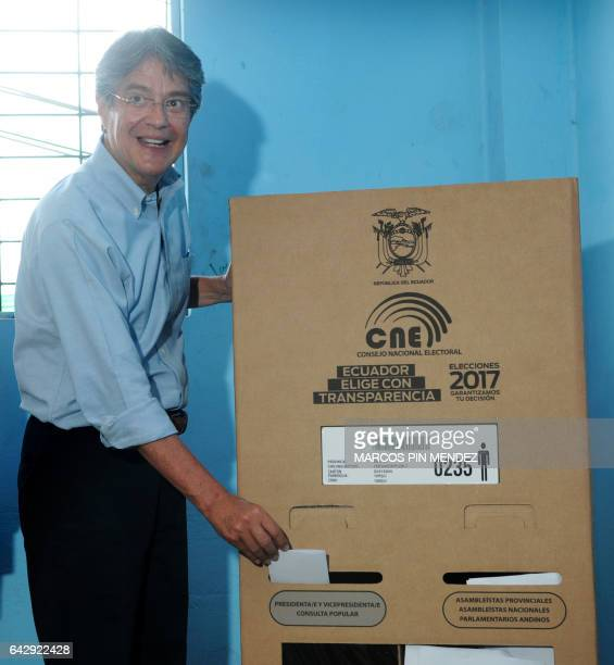 Ecuadorean presidential candidate for the CREO party Guillermo Lasso casts his vote at a polling station in Guayaquil Ecuador on February 19 2017...