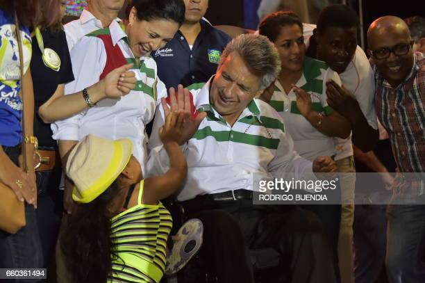 Ecuadorean presidential candidate for the ruling Alianza Pais party Lenin Moreno greets supporters during his campaign closing rally in Portoviejo...