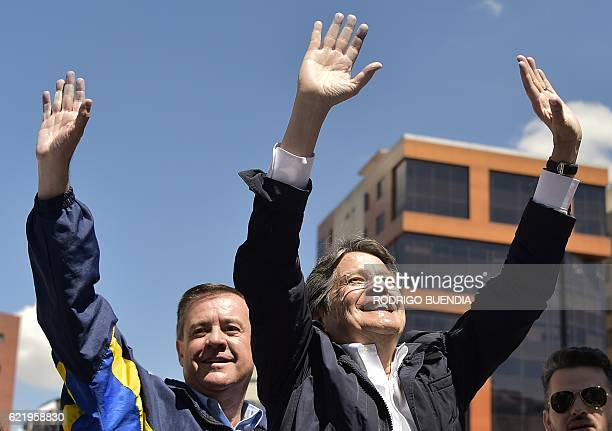 Ecuadorean presidential candidate Guillermo Lasso and Andres Paez candidate to vicepresident walk in Quito on November 9 2016 Lasso and Paez...