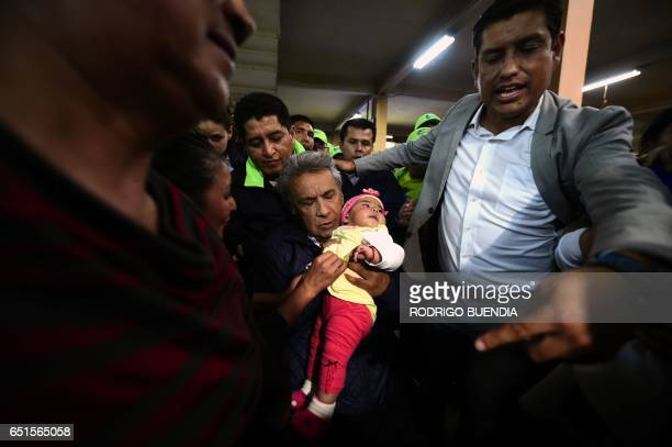 Ecuadorean presidential candidate Lenin Moreno participates in a lunch with the people in the central market of Quito on March 10 2017 The campaign...