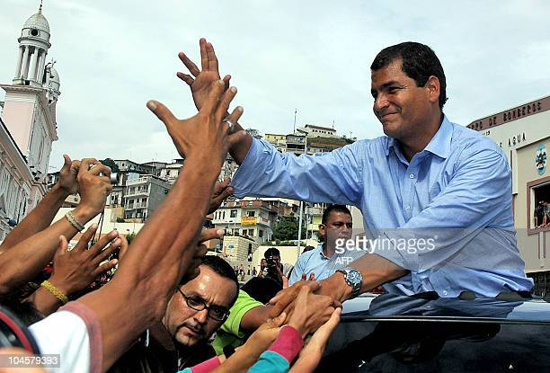 Ecuadorean presidential candidate Rafael Correa greets supporters in Guayaquil Ecuador 26 November 2006 Voting was under way in Sunday with leftist...