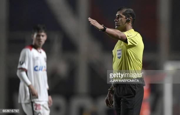 Ecuadorean referee Roddy Zambrano gestures during the Copa Libertadores 2017 group 4 football match between Argentina's San Lorenzo and Brazil's...