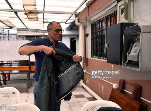 Ecuadorean Vice President Jorge Glas puts his jacket on during an exclusive interview with the AFP from the prison where he is kept in pretrial...