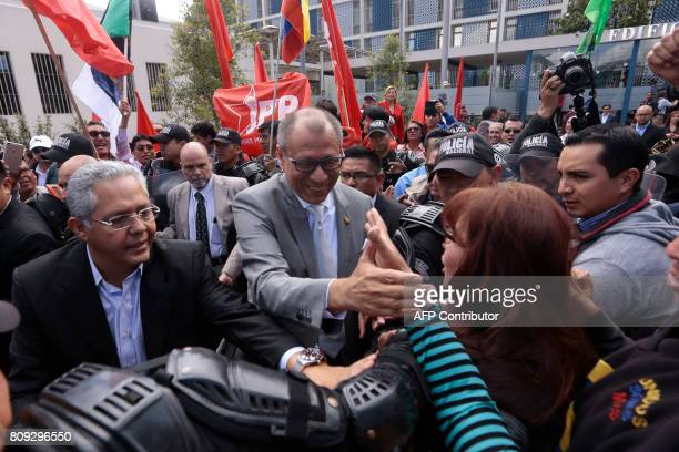 Ecuadorean VicePresident Jorge Glas is greeted by supporters of the ruling Alianza Pais party after testifying on the corruption case of Brazilian...