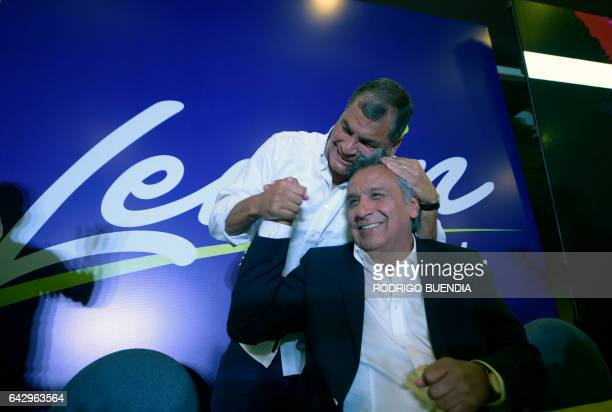 TOPSHOT Ecuadorian President Rafael Correa hugs Lenin Moreno the presidential candidate of the governing Alianza PAIS party at a hotel in Quito after...