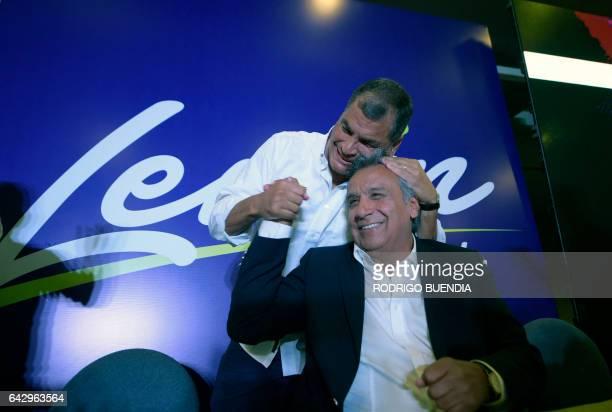 TOPSHOT Ecuadorian President Rafael Correa hugs Lenin Moreno the presidential candidate of the governing Alianza PAIS party at a hotel in Quito after...