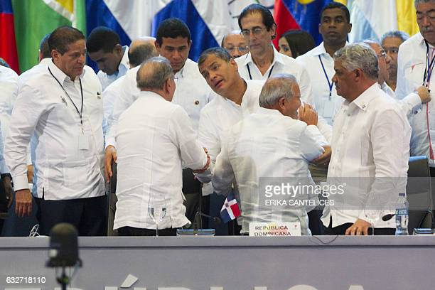 Ecuadorian President Rafael Correa shakes hands with Dominican President Danilo Medina in the plenary session during the Fifth Summit of the...