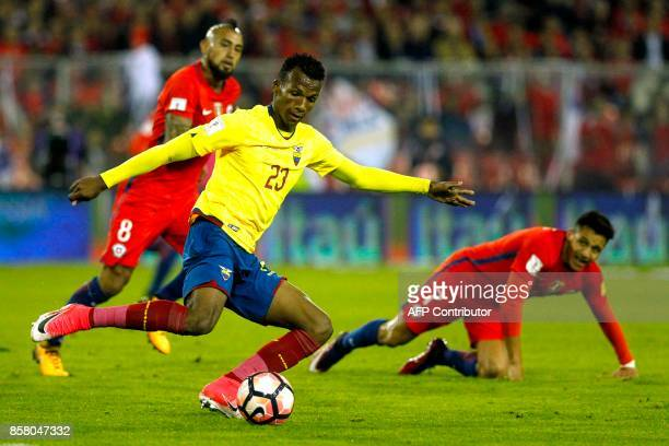 Ecuador's Dario Aimar strikes the ball as Chile's Arturo Vidal and Alexis Sanchez look on during their 2018 World Cup qualifier football match in...