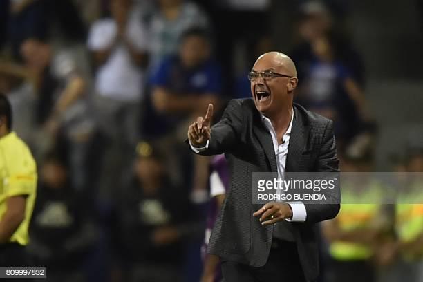 Ecuador's Emelec coach Alfredo Arias gestures during their 2017 Copa Libertadores football match against Argentina's San Lorenzo at George Capwell...
