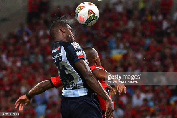 Ecuador's Emelec Gabriel Achilier heads the ball during their 2014 Copa Libertadores football match Brazil's Flamengo against Ecuador's Emelec at...