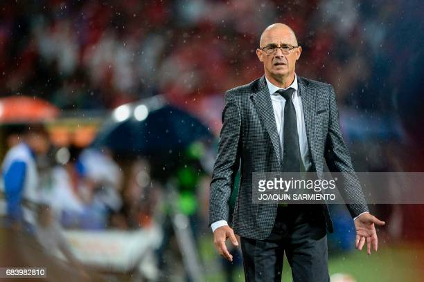 Ecuador's Emelec head coach Uruguayan Alfredo Arias reacts during their 2017 Copa Libertadores football match against Colombia's Independiente...