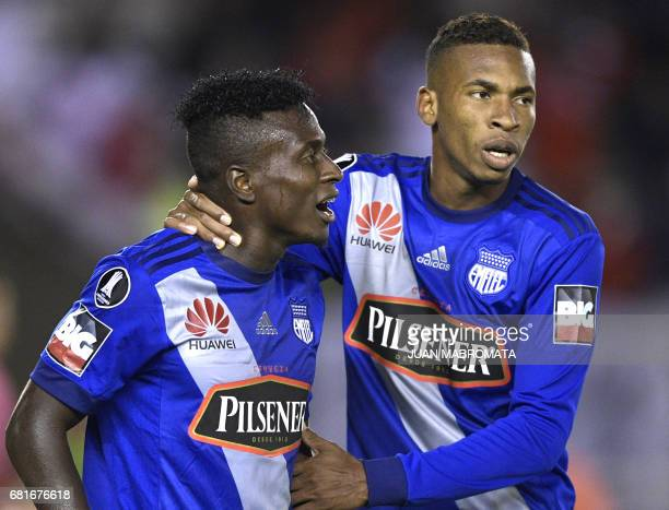 Ecuador's Emelec midfielder Eduar Preciado grabs teammate defender Carlos Moreno after commiting a penalty scored by Argentina's River Plate forward...