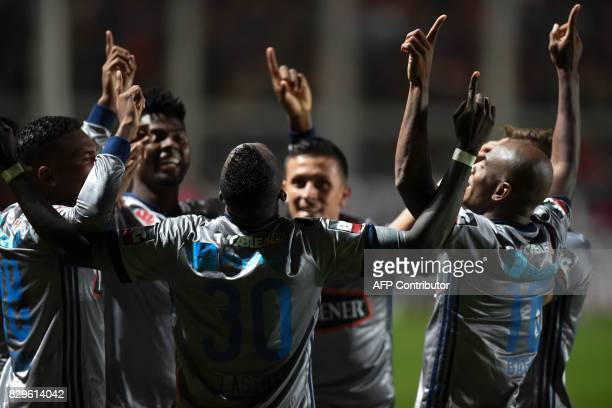 Ecuador's Emelec midfielder Osbaldo Lastra celebrates with teammates after scoring against Argentina's San Lorenzo during their Copa Libertadores...