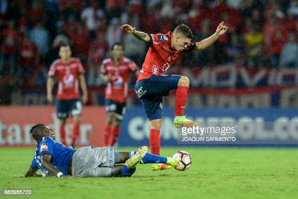 Ecuador's Emelec midfielder Osbaldo Lastra vies for the ball with Colombia's Independiente Medellin midfielder Juan Quintero during their 2017 Copa...