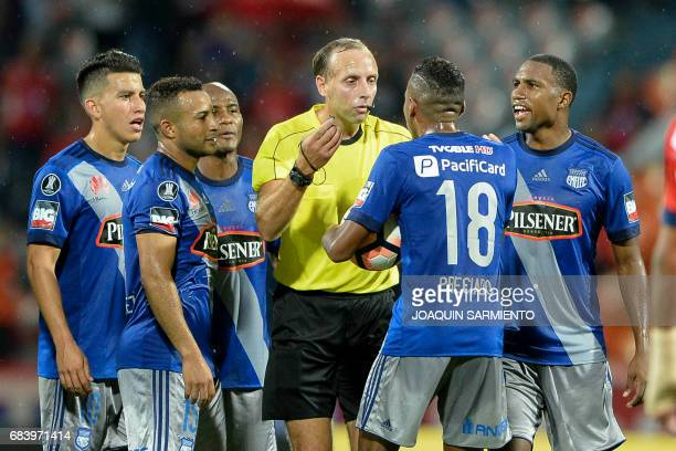 Ecuador's Emelec players protest Uruguayan referee Daniel Fedorczuk during their 2017 Copa Libertadores football match against Colombia's...