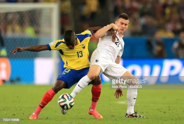 Ecuador's Enner Valencia and France's Laurent Koscielny battle for the ball